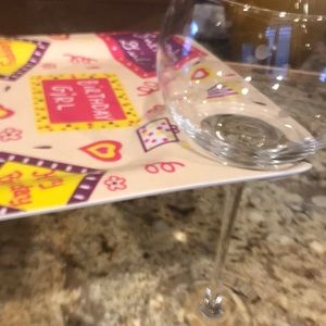 4 birthday girl plates which hold a wine glass